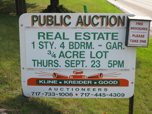 Advertising an auction by using signs, brochures, social media, and newspapers.